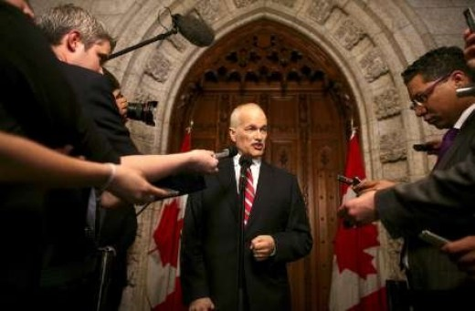 Addressing reporters in Ottawa on issues of the Federal Budget