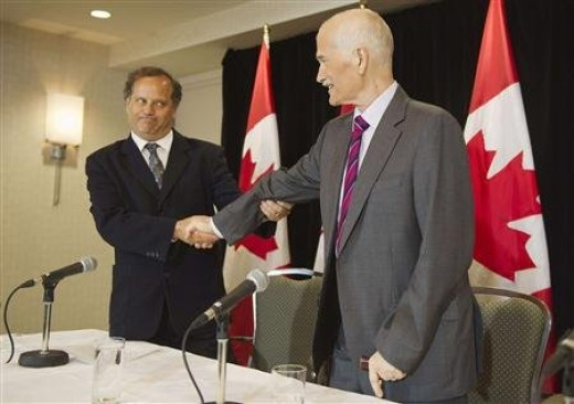 New Democratic Party  leader Jack Layton shakes hands with the President of the NDP Party