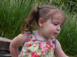 The processed pic of my grand daughter. I changed her earrings, ponytail holder, and trim of her shirt all to purple.