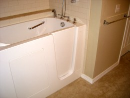 Grab bars around tub.  Notice tub is a walk-in tub.