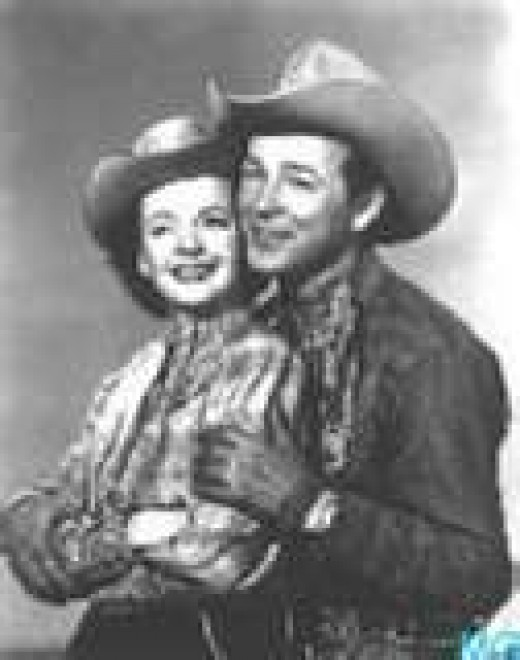 ROY ROGERS AND DALE EVANS, romantic sidekicks? I suppose. It was never revealed in those days that Roy and Dale had any romantic sparks. Code of Morality, you know.
