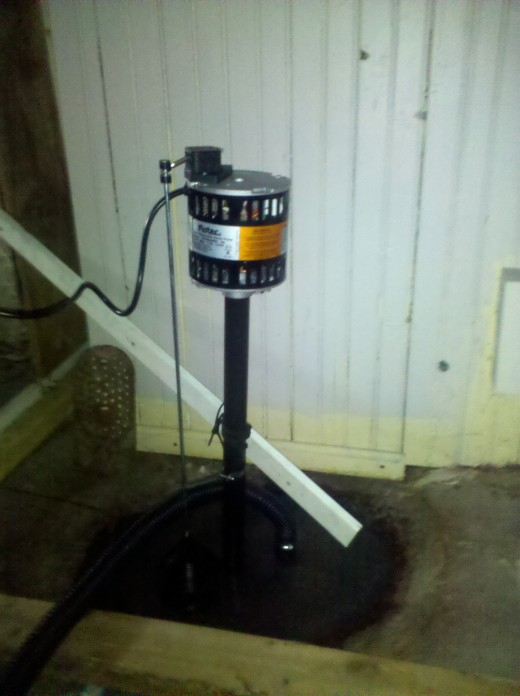 Basement Sump Pump in an old leaky basement. These pumps are easy and fast to install and will continuously pump out flooded rain water.