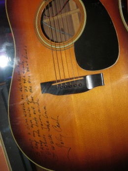 "Guitar signed by Johnny Cash, includes the first few lines of ""I Walk The Line"""