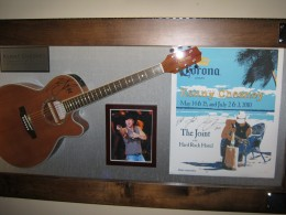Kenny Chesney's exhibit, includes a signed guitar.