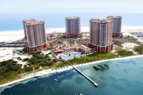 Aerial photo of the five towers of Portofino Resort. Pensacola Beach, Florida. Photo taken above Pensacola Bay, facing towards the Gulf of Mexico.