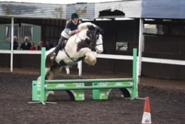 A lesson in the mnage surrounded by the square track at St Leonards Riding School