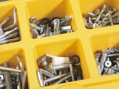 Nails, Bolts and Screws Organized in Yellow Plastic Container