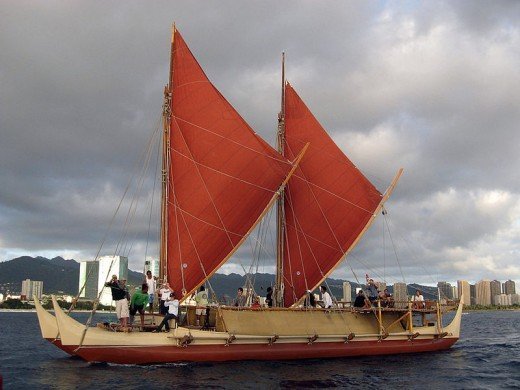 The Hokule'a.  This 'voyaging canoe' made a 4,400-km trip Hawaii-Tahiti voyage.  Its design, like traditional navigation, is a culture trait strongly subject to selective pressure and hence adaptation.  Image courtesy Hongkonghuey & Wikipedia.