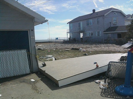 two more home damaged along the beach in Milford, CT from Hurricane Irene, that's supposed to be an empty lot in between.