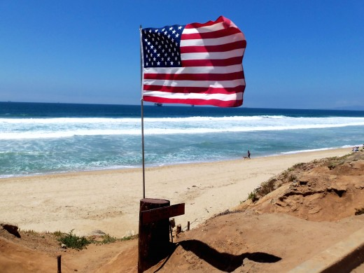 "- A subtle inconspicuous three foot tall memorial stands at Huntington Beach California in commemoration - A simple message is hand carved into a small piece of wood - ""ALL GAVE SOME & SOME GAVE ALL""  -"