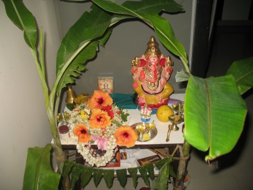 Both Sri.Gowri and Sri.Ganesh are kept on a clean Tea Stand or any pedastal with either side a Banana sampling tied ready for pooja.