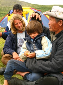 Horse Boy author Rupert Isaacson and his son Rowan sit with a Shaman healer in Mongolia