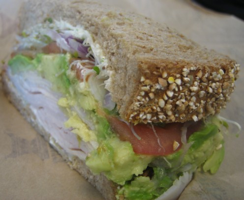 To eat less bread on a low carb diet, eat only half a sandwich, packed with low carb fillings