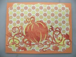 Large pumpkins adhered to card