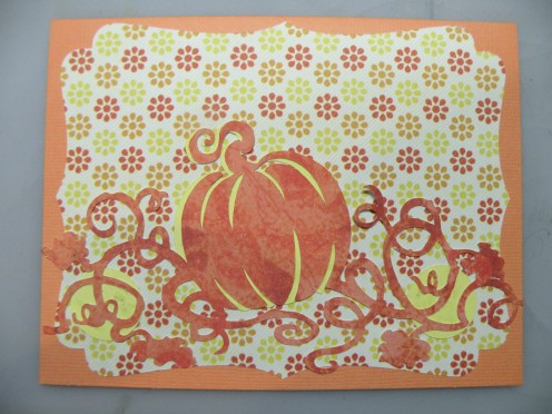 Large pumpkins adhered to card