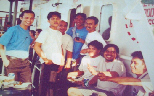 Filipinos (with the sailor, wearing blue shirt-extreme left) on board the old ship) (Photo by thesailor, 2002)