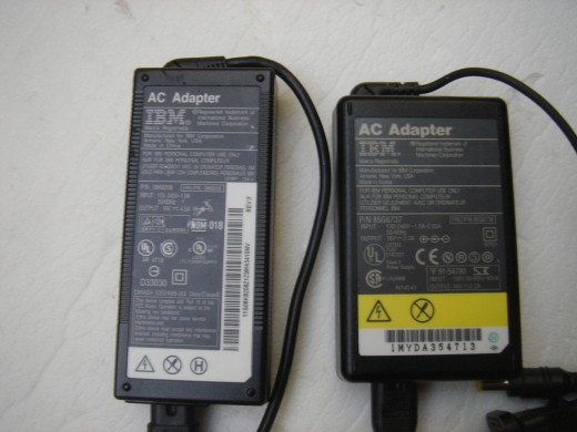 Normal AC adapter on the left with 4.5A power output. The right was given along with the T42, having 2.2A power output.