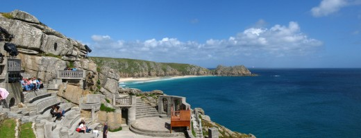 A picture of the Minack Theatre with the coast of Cornwall in the background.
