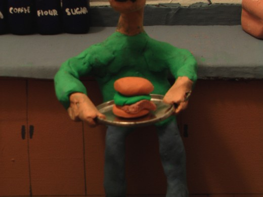 "Prop Hamburger used in claymation cartoon, ""Charlie Butters: Floor Burgers."""