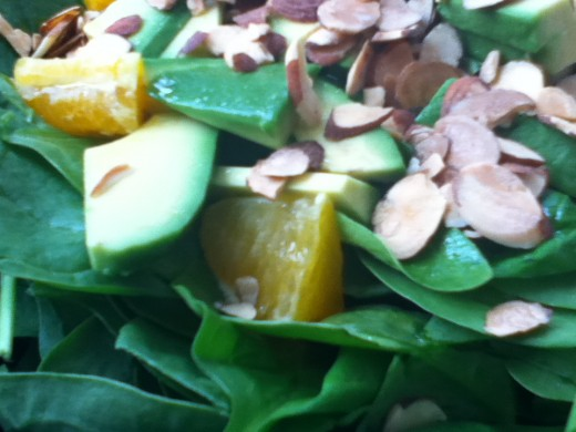 An easy salad using spinach, avocado, oranges, and toasted almonds.