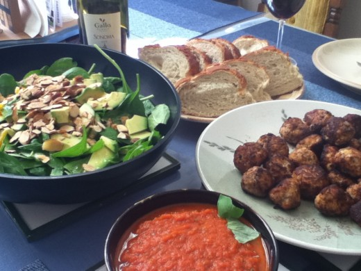 Salad, bread, and marinara with meatballs. The perfect, quick holiday menu.