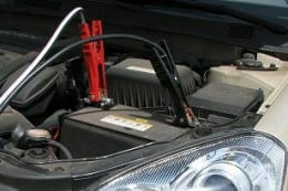 Boosting, or car jumping a dead car battery.
