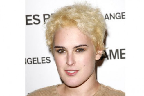 This is wrong on so many levels. What else can be said other than that Rumer Willis CANNOT go platinum blonde and desperately needs hair to frame her face. She ends up looking like a man.