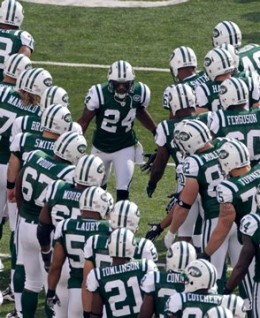 Revis Leads the Jets in the huddle
