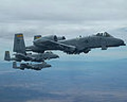 Three A-10 Thunderbolt II aircraft fly in formation over Tucson, Ariz., during an air refueling training mission April 14, 2006. The A-10 aircraft are assigned to the 358th Fighter Squadron at Davis-Monthan Air Force Base, Ariz.