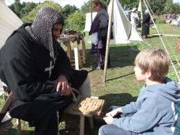Playing Nine Men's Morrris, with 'Sir Richard'