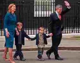 Gordon Brown and familiy leave office,  We imagine with no little relief.