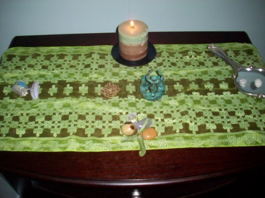A very simple altar set up to honor the 4 elements and deity. Best part is - you can store these items away if you aren't able to leave them out.