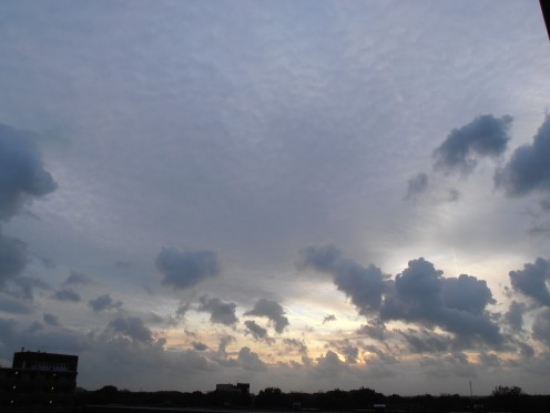 Sun going down, seen through a gap in the clouds..
