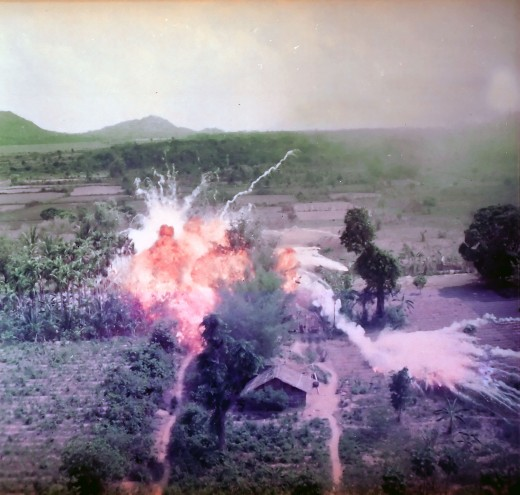 Napalm bombs explode on Viet Cong structures south of Saigon in the Republic of Vietnam.