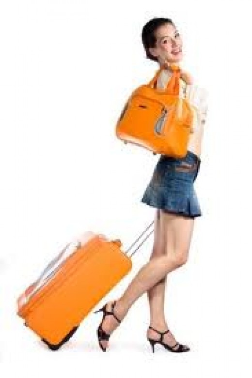 Two pieces of luggage are ideal.  Less stress when carrying your luggage, and you save on baggage fees as well!