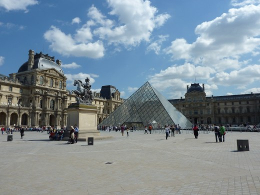 The Louvre Museum with the Pyramid in front of the main buildings