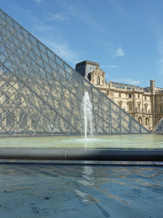 A fountain next to the Louvre Pyramid
