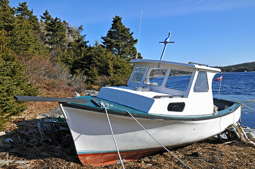 Boats normally in water are finding themselves further away from water than this one.