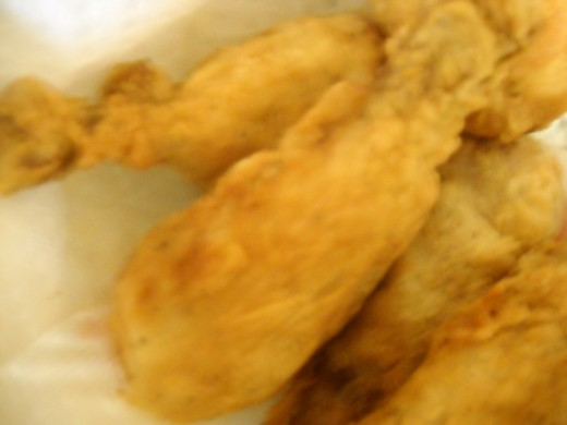 Batch of fried chicken drumsticks