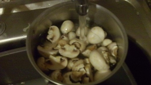 Fill the pan with cold water which should just cover the mushrooms.