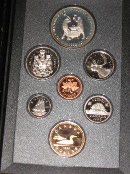 This coin proof set display, never touched by human hands highlights a variety of Canadian coins.