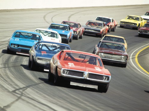 STOCK CAR RACES ARE NOW A BOOMING INDUSTRY IN THE SOUTH. THIS BUSINESS STARTED FROM A HANDFUL OF GUYS WHO HAULED MOONSHINE FOR A LIVING.