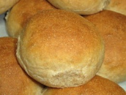 Soft golden brown buns fresh from the oven.