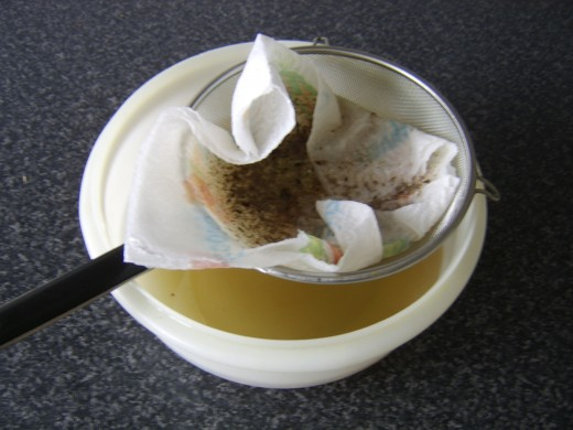 Strain the stock through a sieve and some kitchen paper