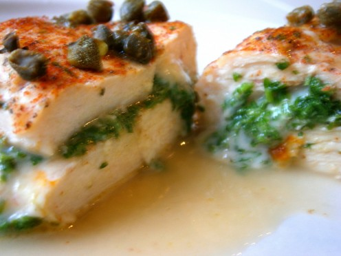 Parsley stuffed chicken with capers and white wine--just the dish to please both palette and whim.