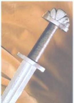 Viking sword. Blade and hilt were made in one, decorated to taste. Made from three lengths of steel, they were forged and beaten together, 'pattern-welded' with a central channel down the blade to ease the withdrawal after 'running the foe through'