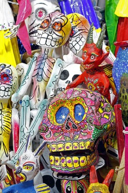 mexican folk art Paper mach figures in Guanajuato Market, Mexico. Intricate color patterns and color combinations are characteristic of Mexican folk art, that often dwells in the magical, death, and fantastic.