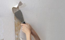 Removing wallpaper with a fabric softener can melt it right off!