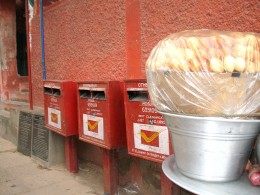 Post Box On Foot Path.Pani-Puri Walla from BIHAR Keeping  Puri Pot with plastic cover may be to prevent air borne Bacteria.