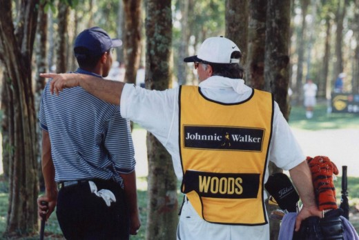 "Tiger in the woods with Mike ""Fluff"" Cowan, his first caddie."